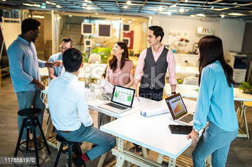 Group of young, modern multi-ethnic people  on business meeting in modern co-working space, suggesting ideas for the best business strategy