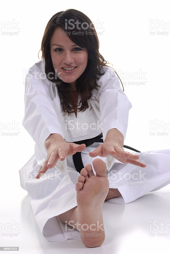 Reaching to stretch royalty-free stock photo