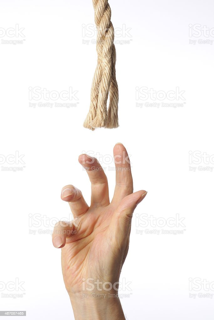 Reaching up a rope against white background stock photo