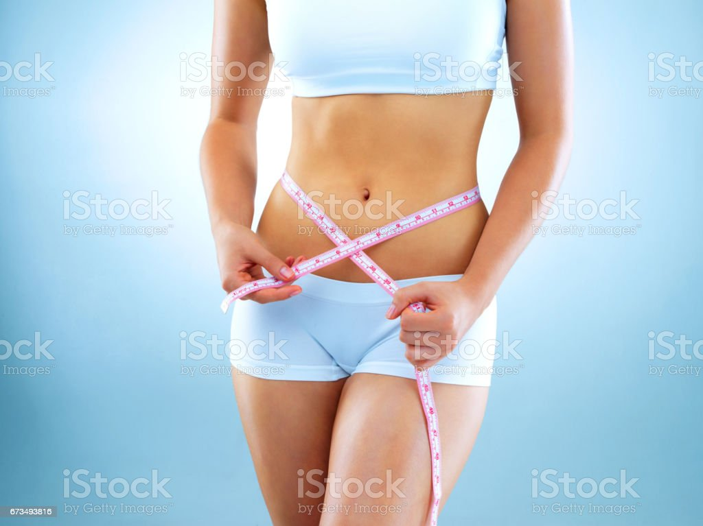 Reaching weight loss goals one inch at a time stock photo