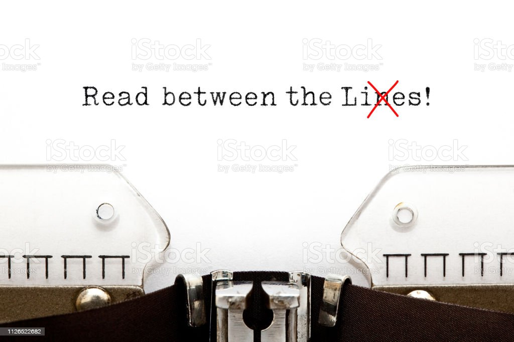 Read Between The Lies Concept On Typewriter stock photo