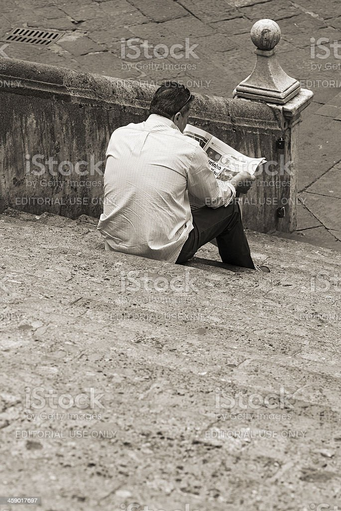 Read the newspaper royalty-free stock photo