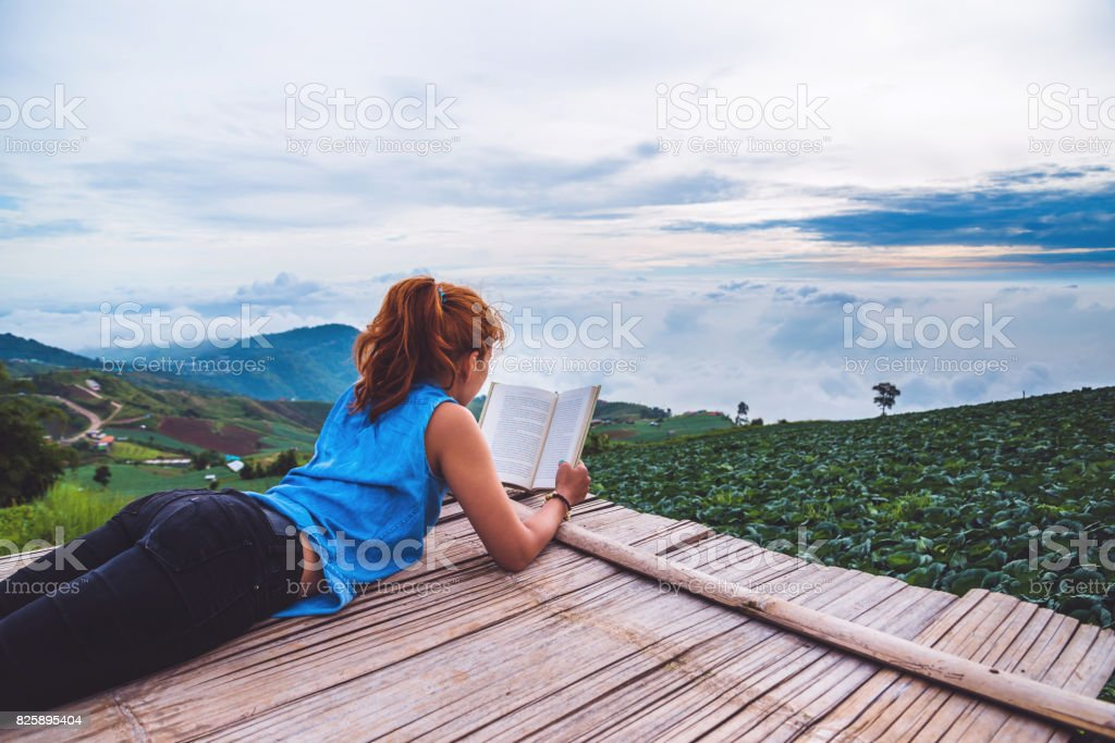 Read women relax in the park. Morning atmosphere The mountains are foggy. phetchabun phutubberg thailand stock photo