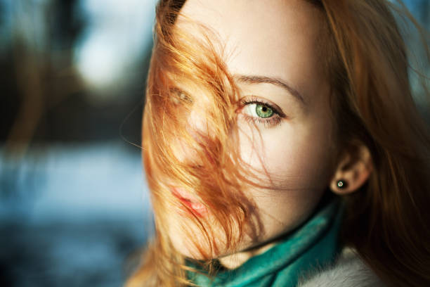 readheaded woman cloase-up portrait - woman green eyes red hair stock photos and pictures