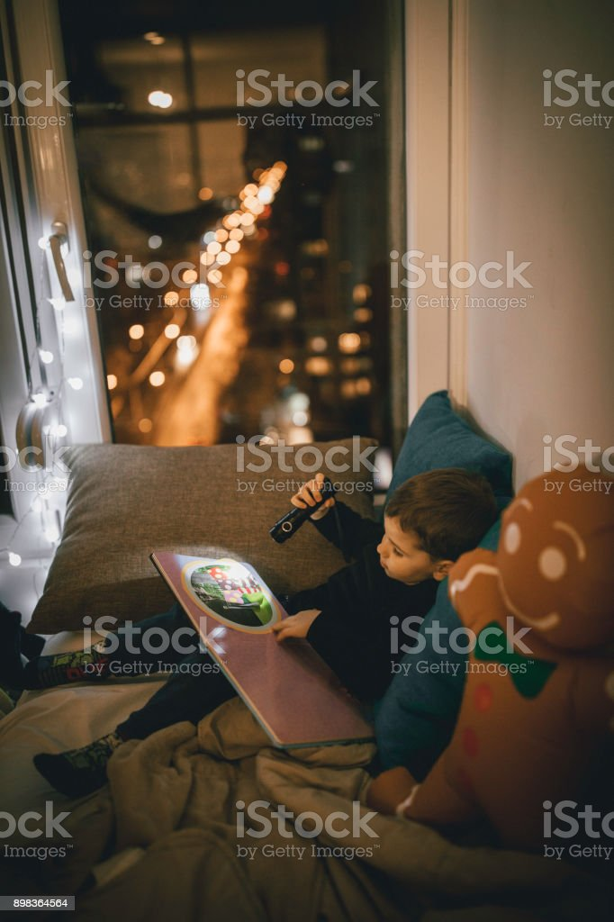 Readig stories at night stock photo