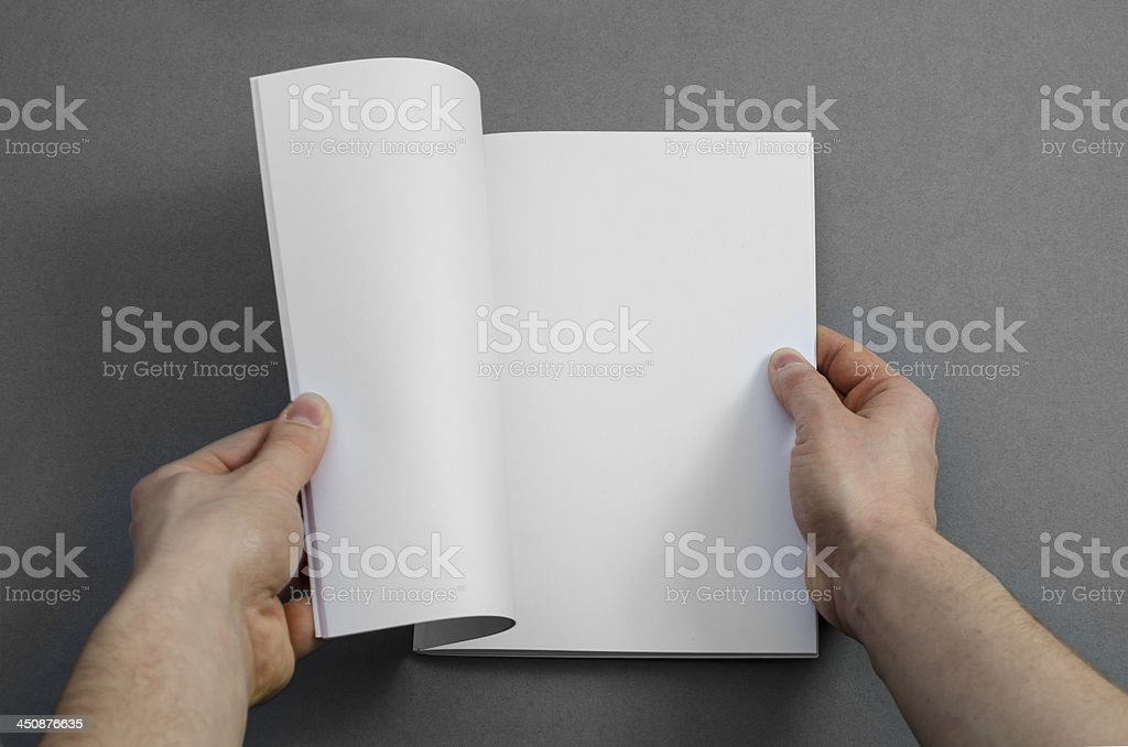 Reading a blank brochure royalty-free stock photo
