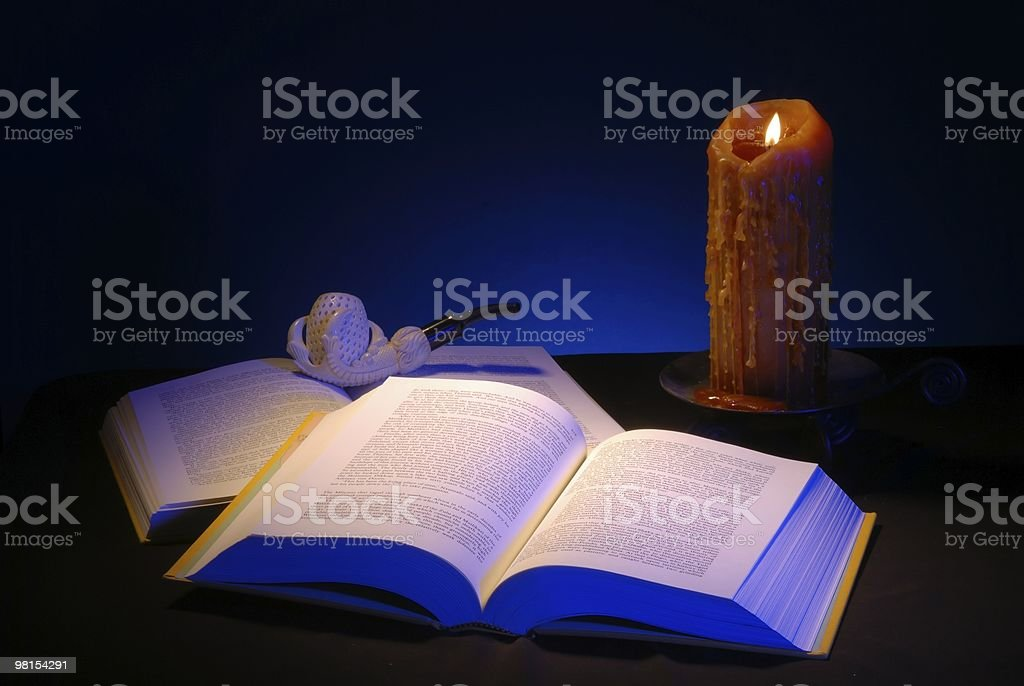 Reading a Book by Candle Light royalty-free stock photo