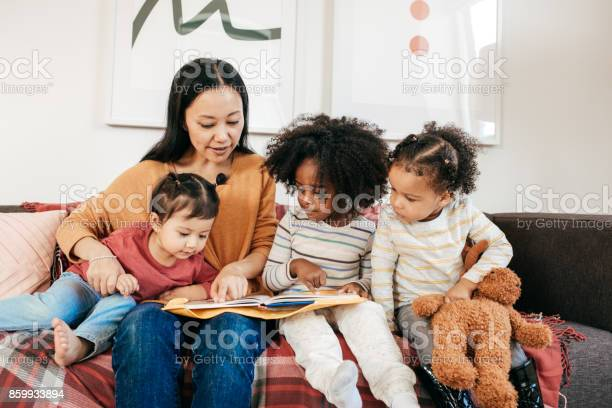 Reading a book for toddlers picture id859933894?b=1&k=6&m=859933894&s=612x612&h=p bsdfrdowu9pf7h4gn5rlzlhwnzr0nik yjjqgy0mg=