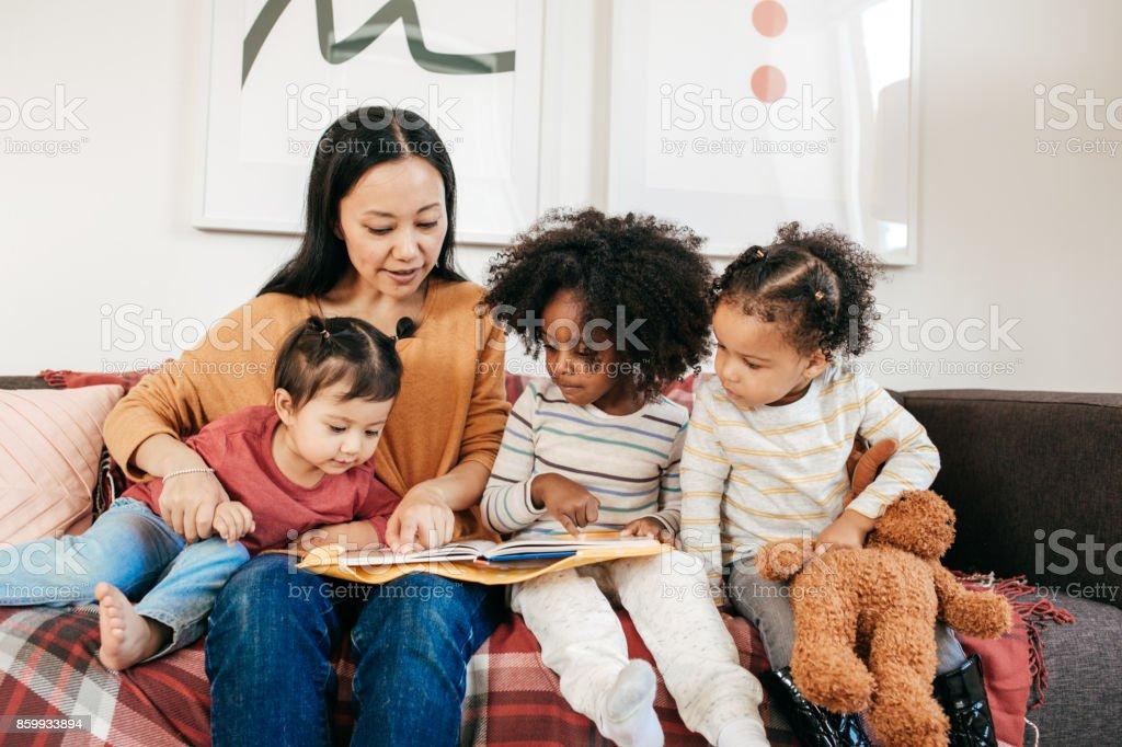 Reading a book for toddlers stock photo