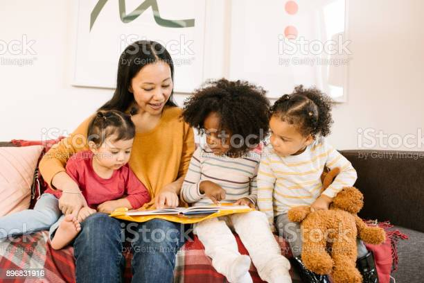 Reading a book for toddlers picture id896831916?b=1&k=6&m=896831916&s=612x612&h=4ejbapnpxg qkwd3rc fjrgw setu3prumgbm2w5 oo=