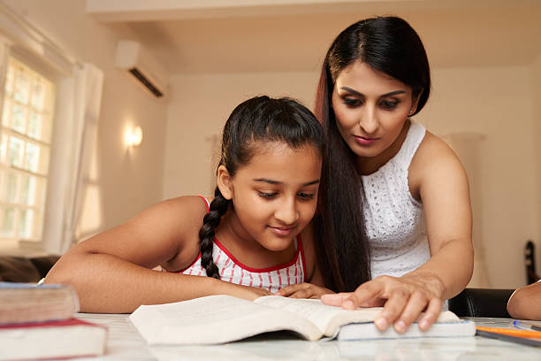 reading a book - homework stock photos and pictures