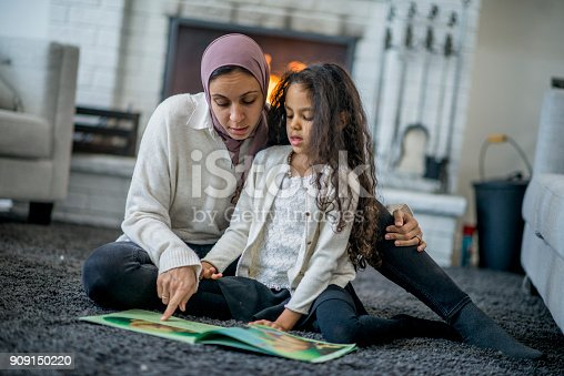 istock Reading A Book Together 909150220