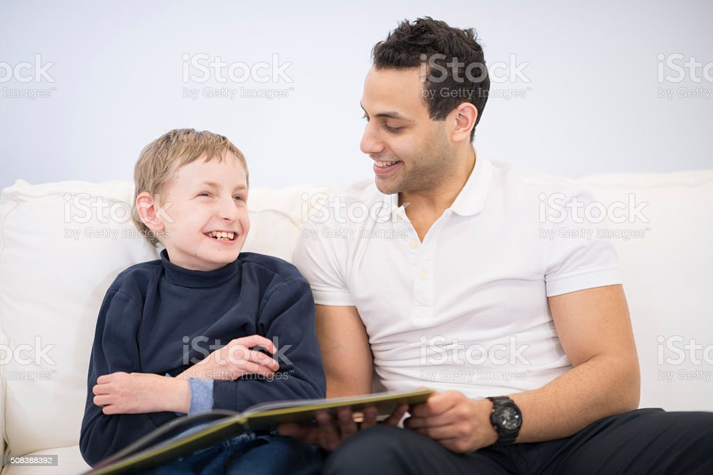 Reading a Book with a Child stock photo