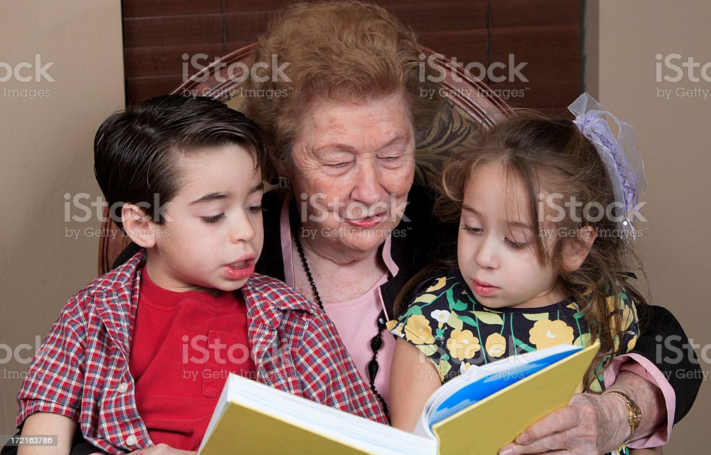 reading a book with Granny stock photo