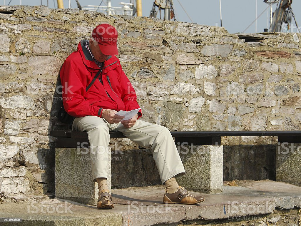 Reading a Letter on the Quay royalty-free stock photo