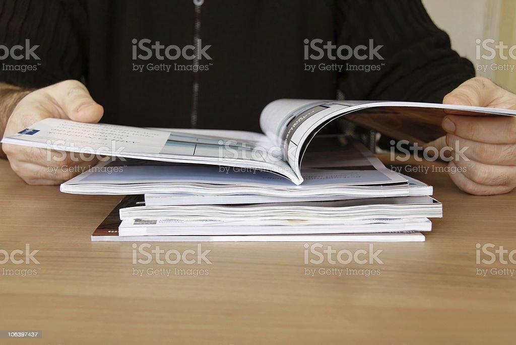 Reading a magazine stock photo