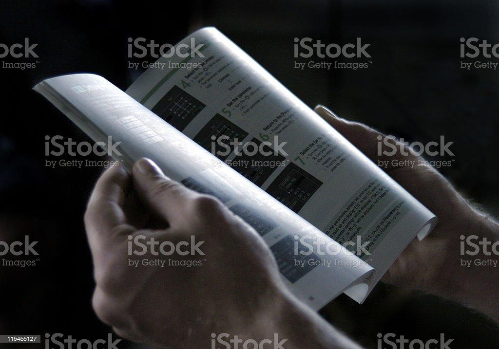 Reading a Manual stock photo