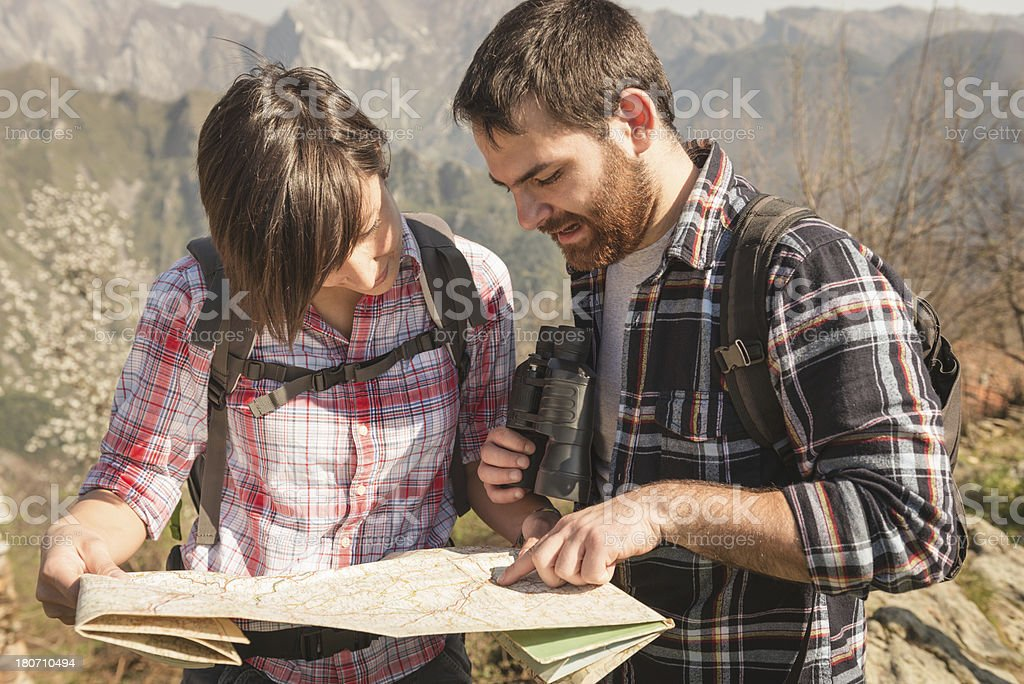 Reading a map on the mountain royalty-free stock photo