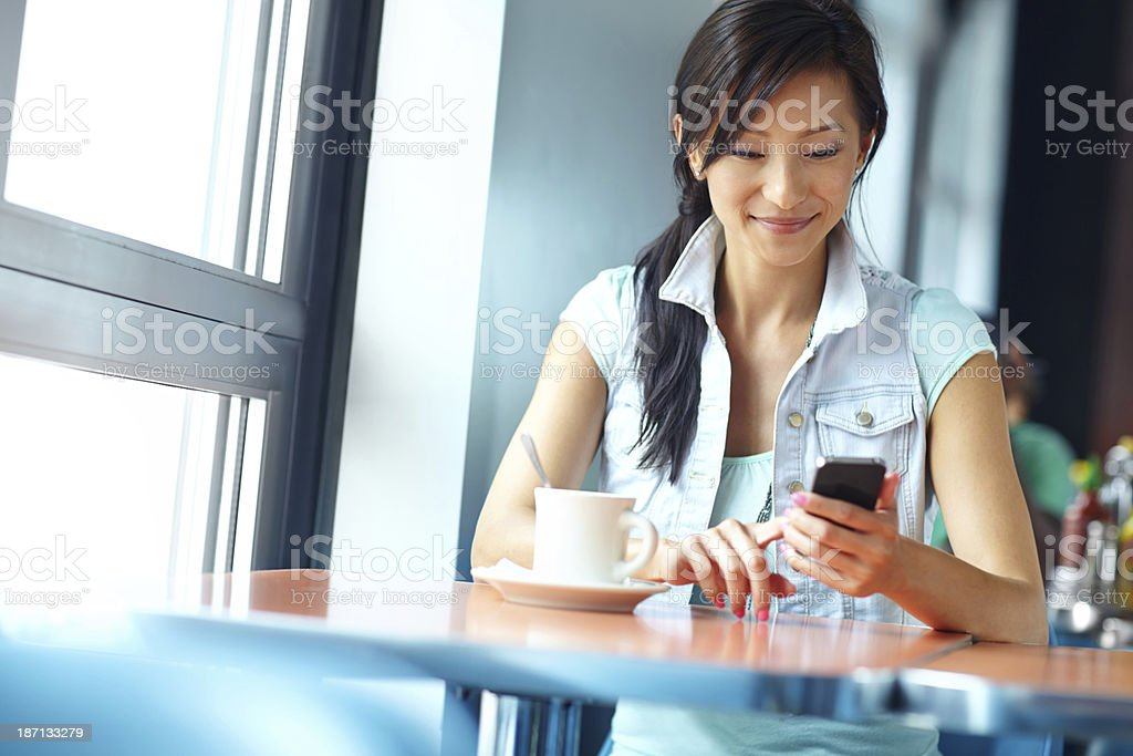Reading a sweet text message royalty-free stock photo