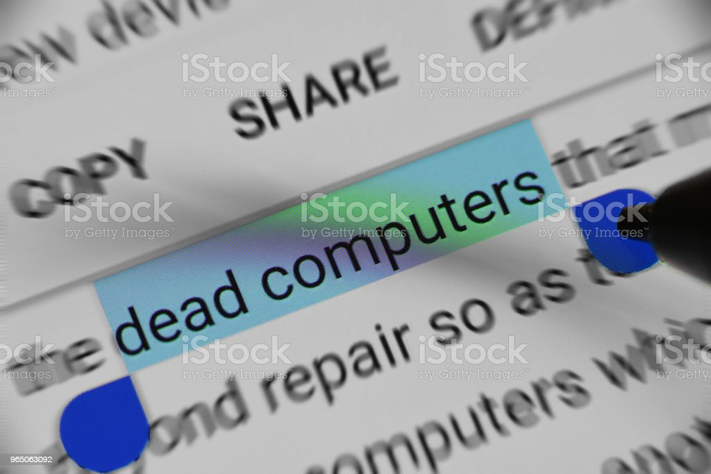 Reading about Information regarding Dead Computers on digital device zbiór zdjęć royalty-free