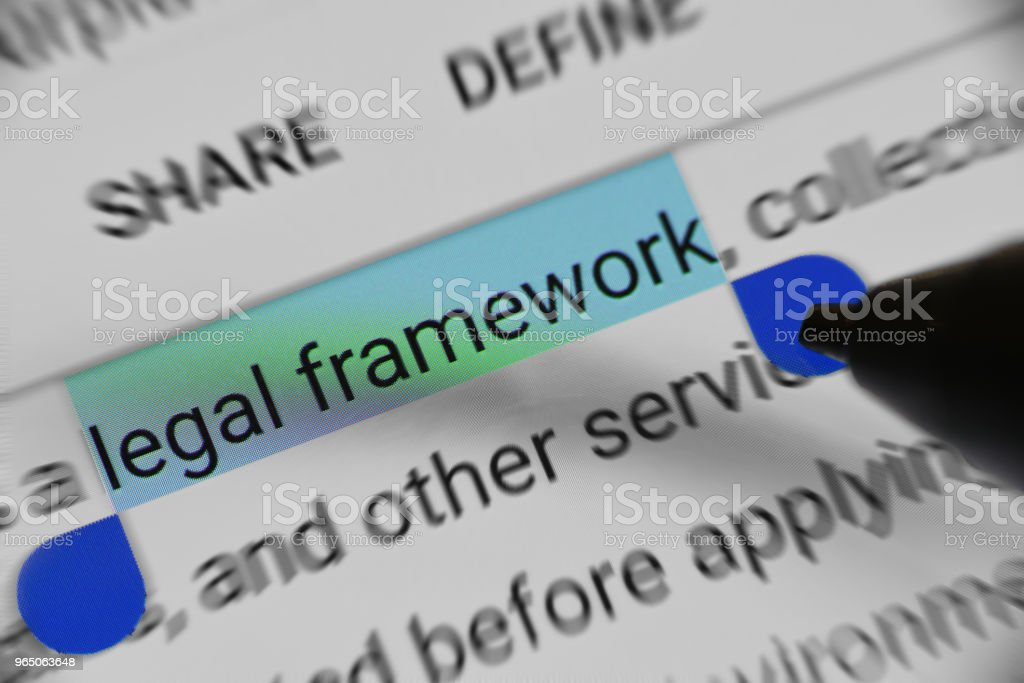 Reading about Legal framework online royalty-free stock photo