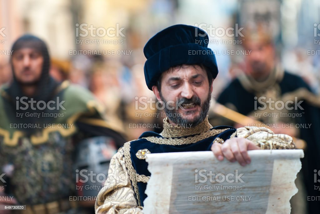 Reading an edict in the middle ages stock photo