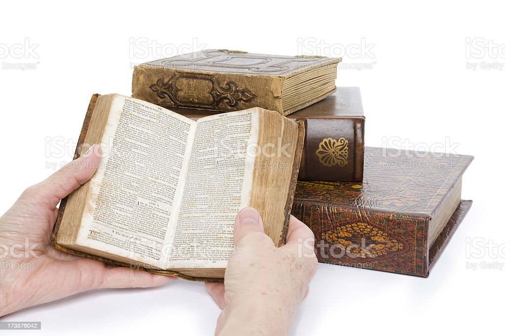 Reading an old Bible (XXL) stock photo