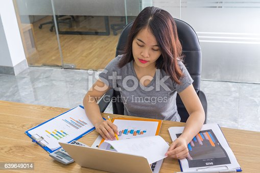 istock Reading and checking reports is the important to business people 639649014