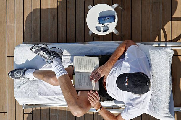 Reading and Relaxing on a Cruise Ship stock photo