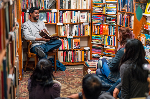 People talking in a book group meeting in a San Francisco bookstore.