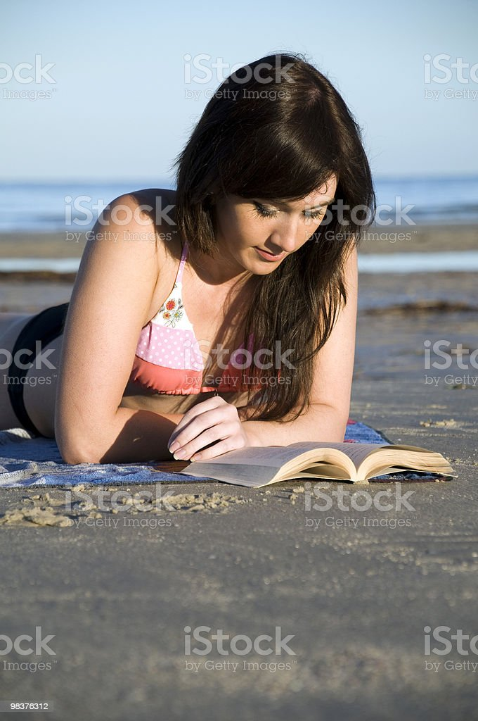 reading at the beach royalty-free stock photo