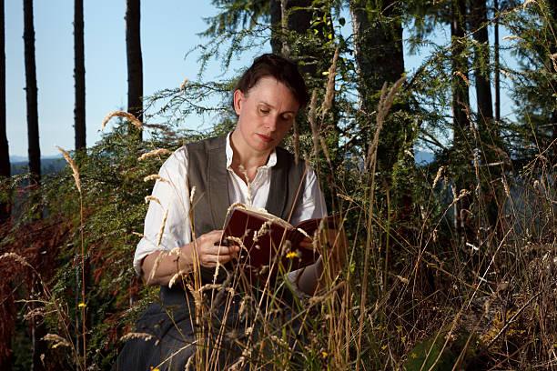 Reading Beneath the Trees stock photo