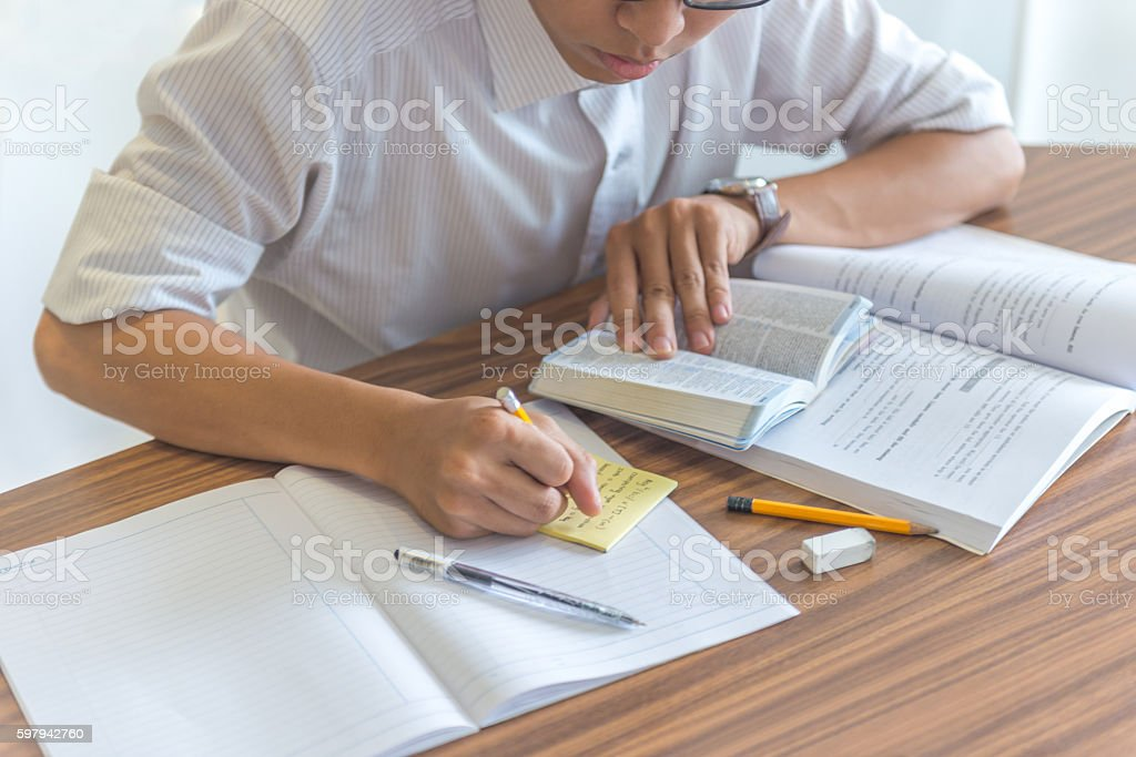 Reading book and self-study is encouraged for every student stock photo