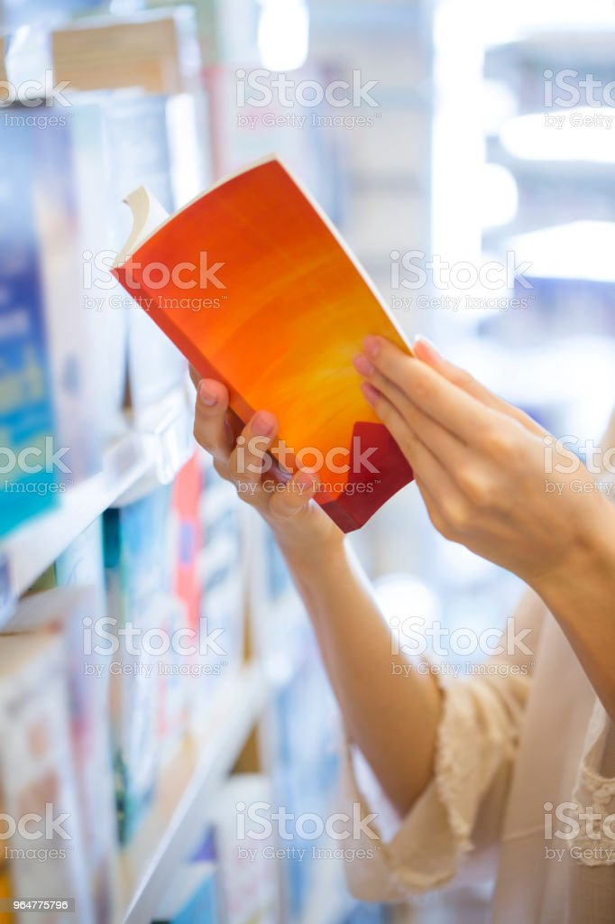 Reading book at the store royalty-free stock photo