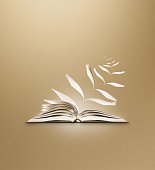 reading book flying pages brown background