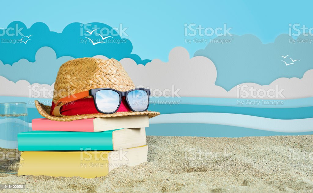 Reading Book on Beach stock photo