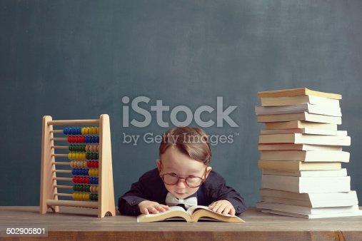 683105722 istock photo Reading book 502905801