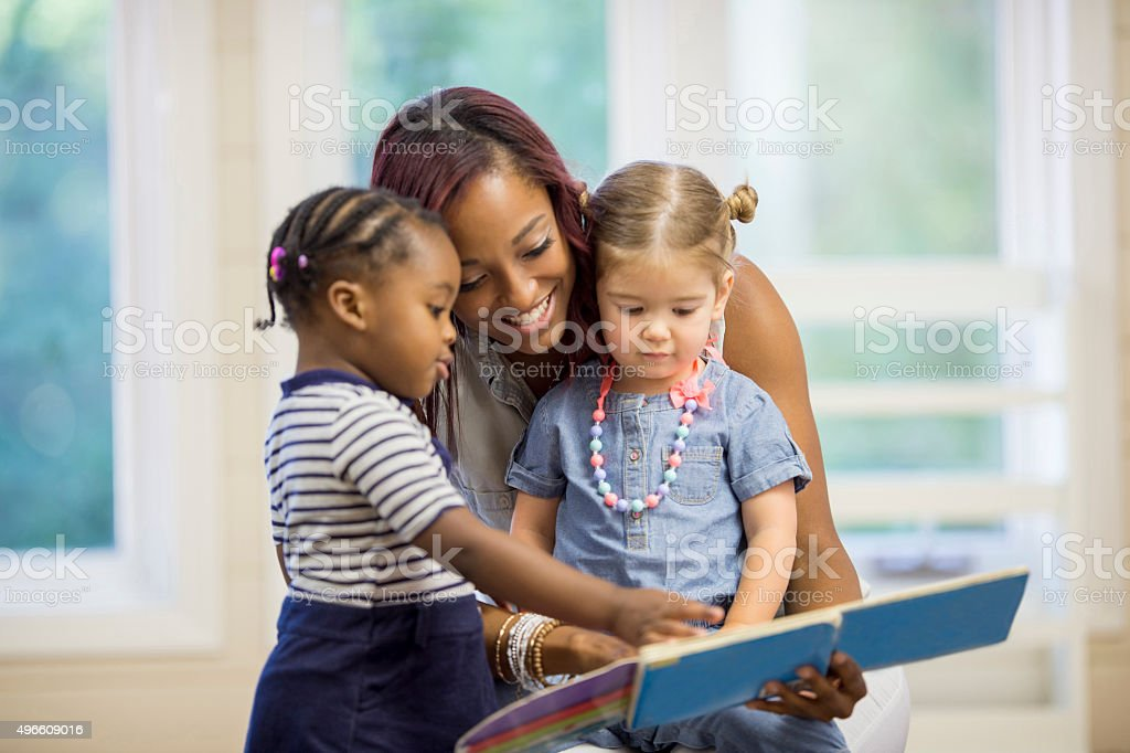Reading Books Rogether in Preschool stock photo