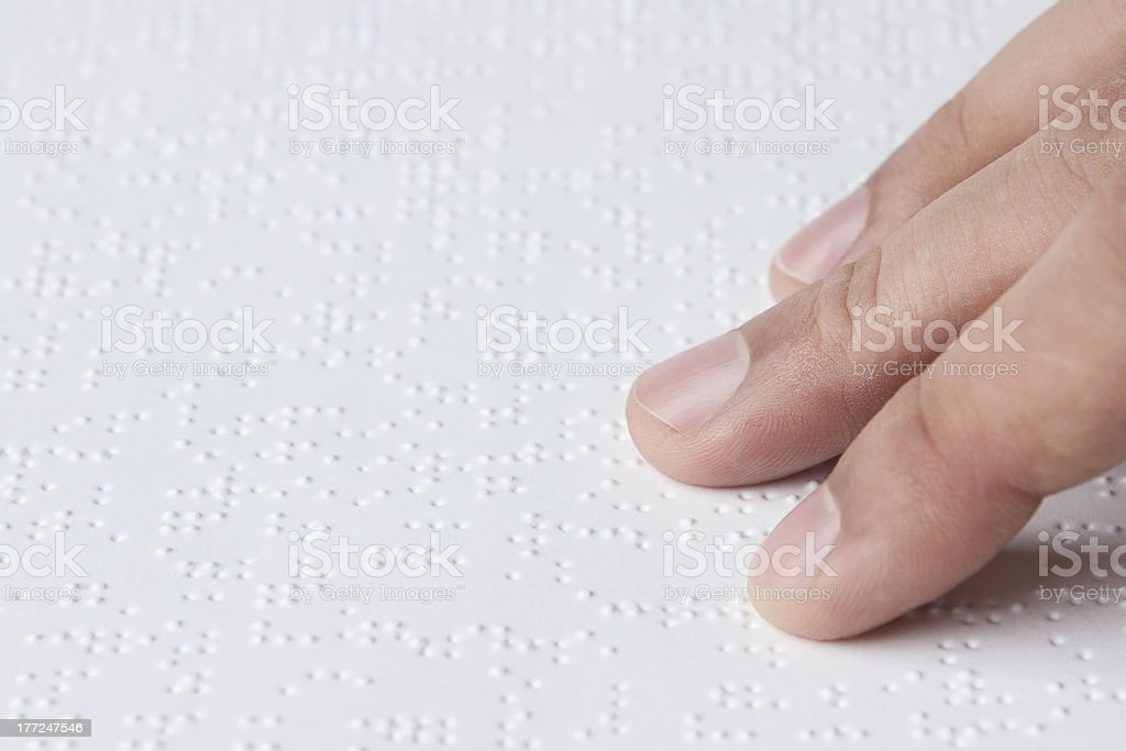 Reading braille text stock photo