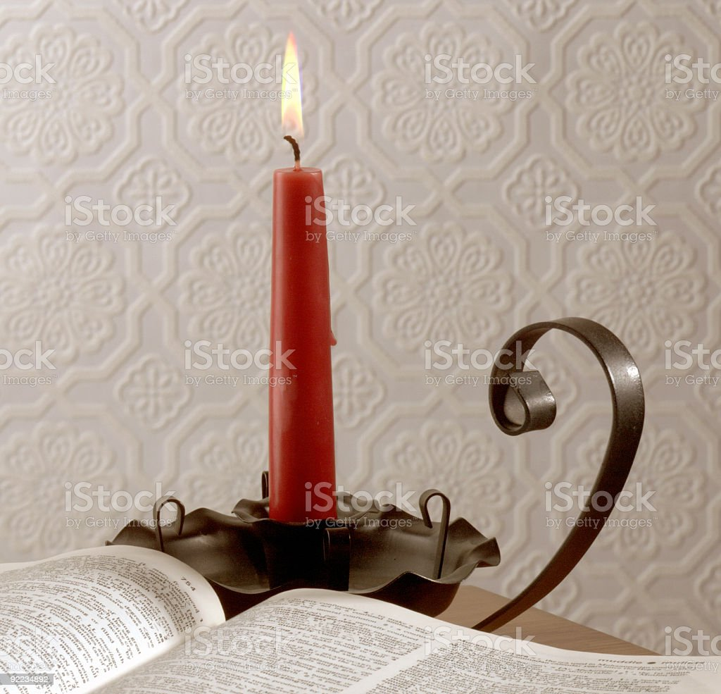 Reading By Candle stock photo