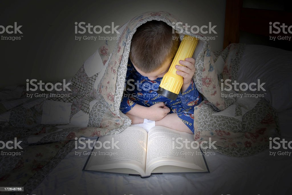 Reading by Flashlight stock photo