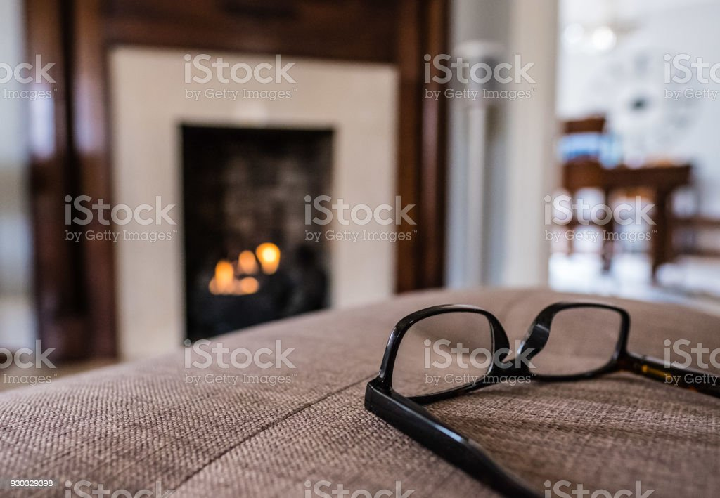 Reading by the Fireplace stock photo