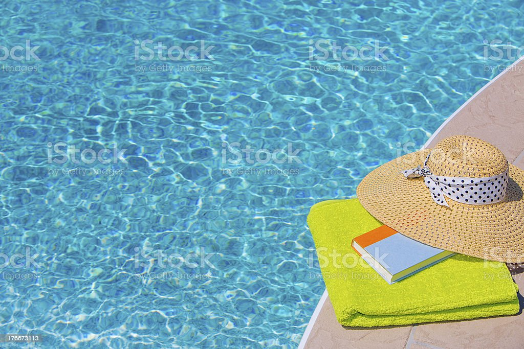 Reading by the pool royalty-free stock photo