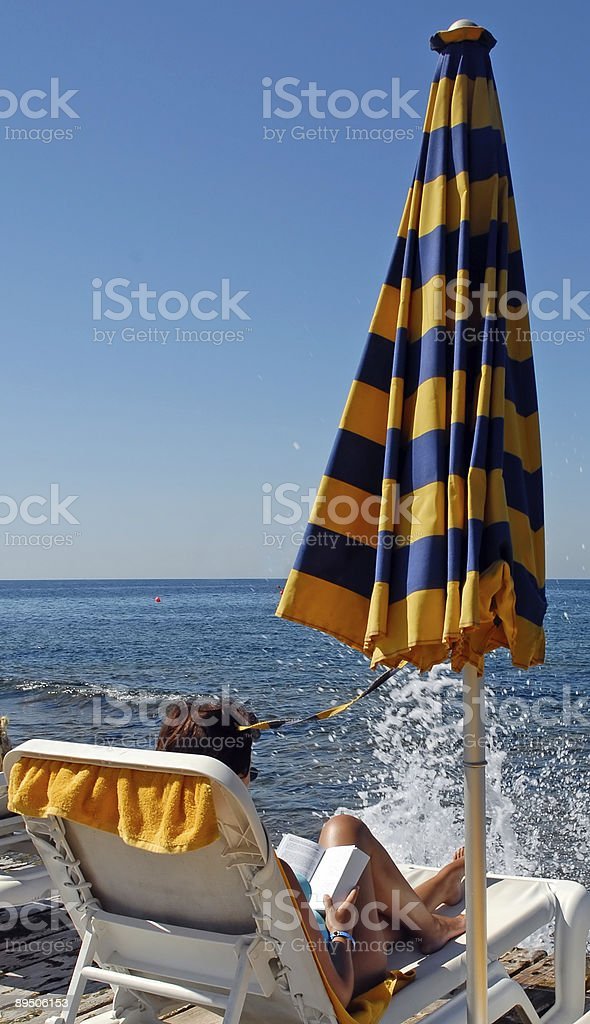 Reading by the sea royalty-free stock photo