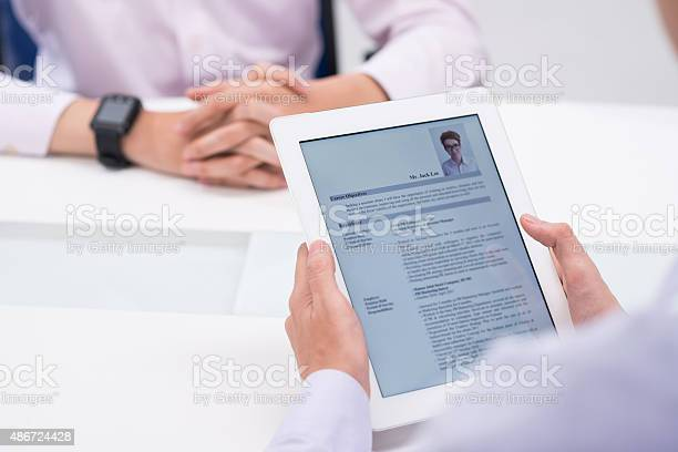 Reading Cv Stock Photo - Download Image Now