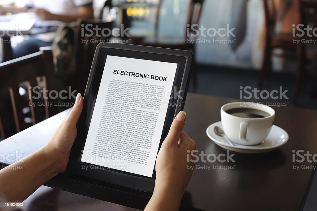 reading E-book on digital tablet royalty-free stock photo