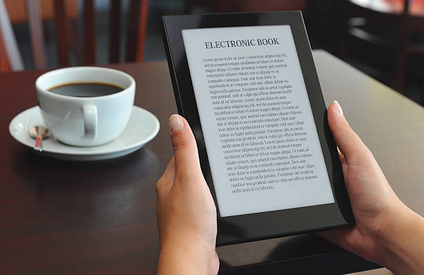 reading E-book on e-reader stock photo