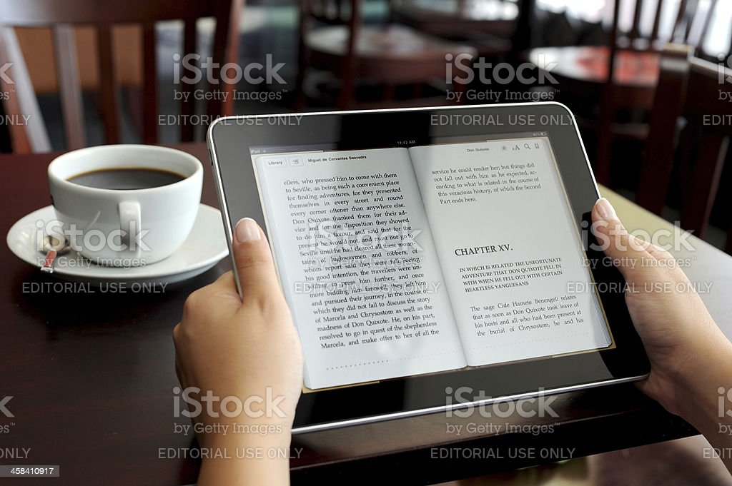 Reading E-book on iPad - Royalty-free Adult Stock Photo