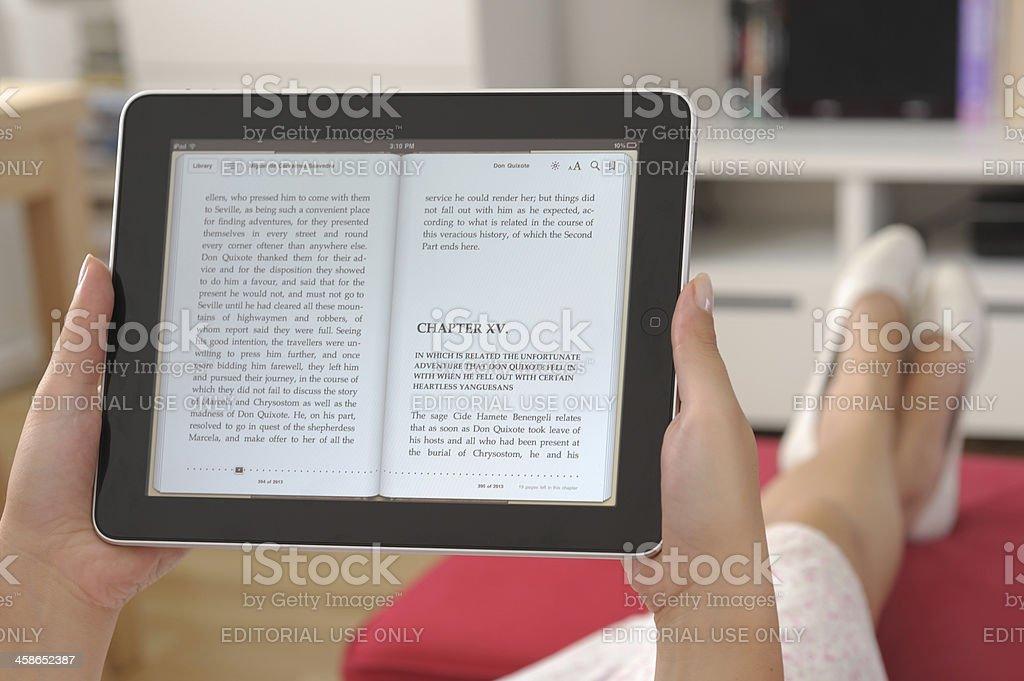 Reading E-book on iPad royalty-free stock photo