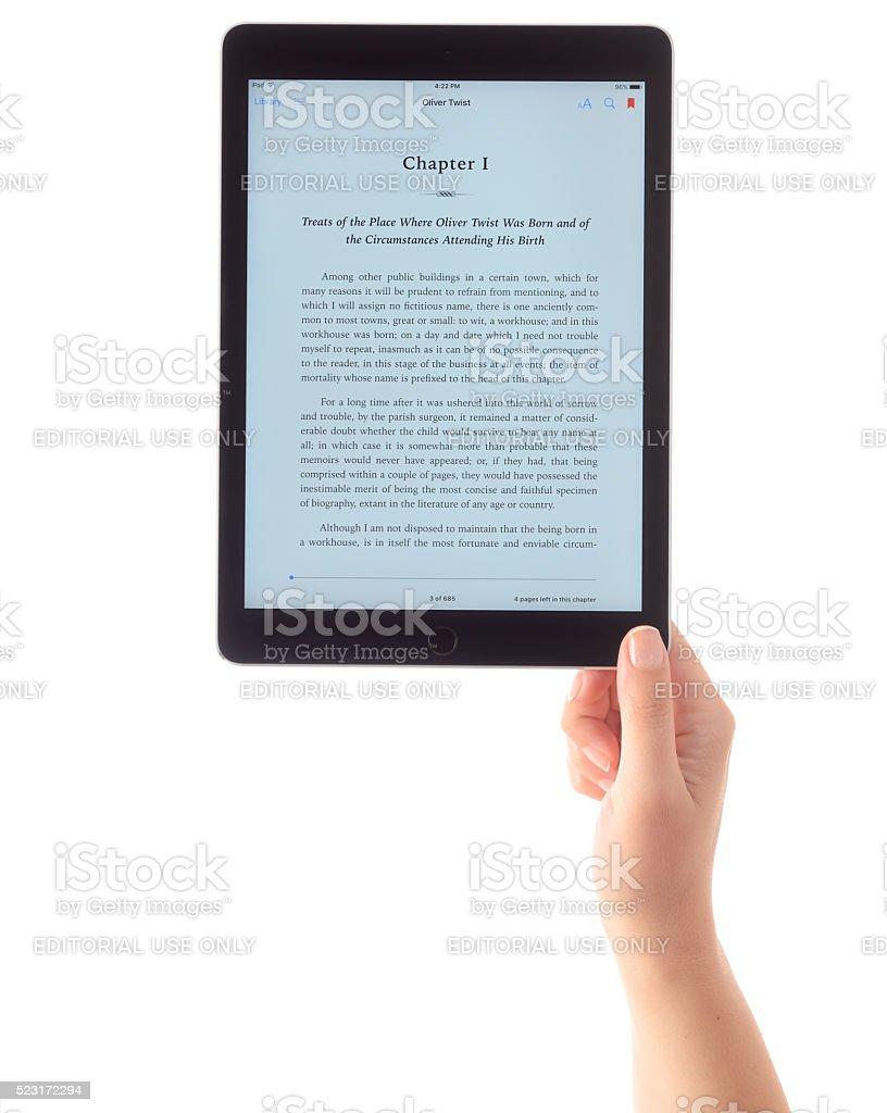 Reading e-book with iPad Air 2 stock photo